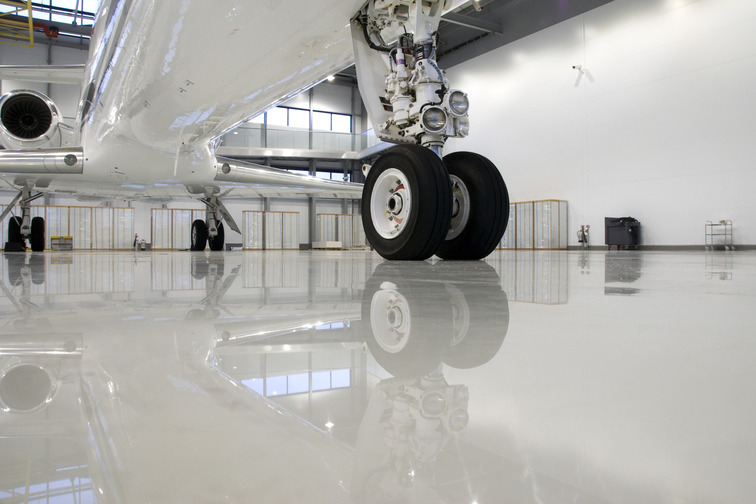 High wear, industrial, epoxy flooring systems that are chemical resistance and can handle heavy traffic and large equipment.