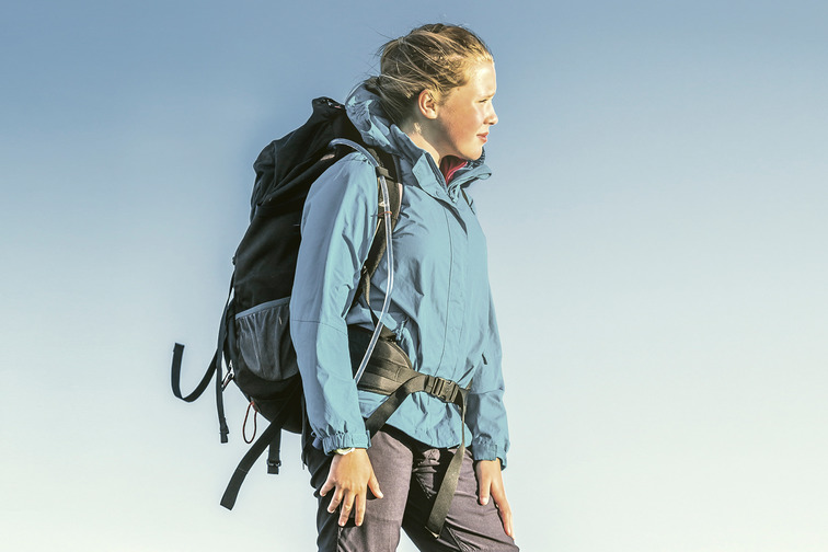 Woman with hiking equipment