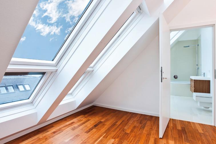 Skyliight, open door in a room, wooden floor