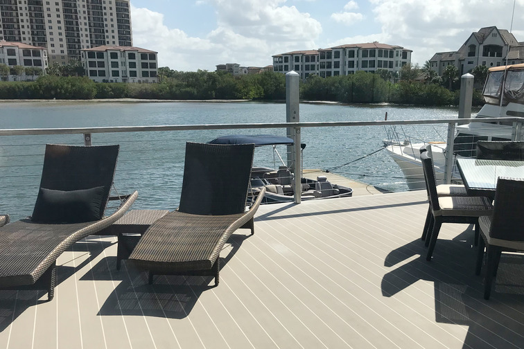 2 deck chairs on a synthetic teak floor