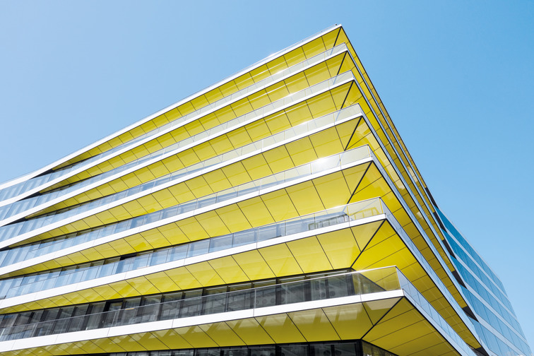 Building with yellow glass balustrades