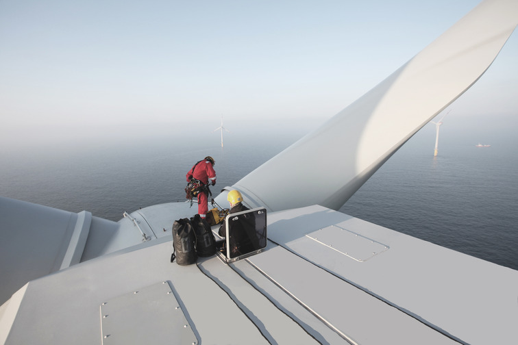 Man on a wind turbine for maintenance and repair